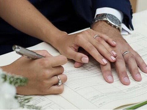 Couple in love signing marriage document.
